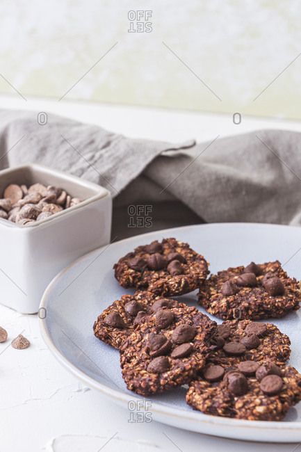Some sugar free freshly baked oatmeal and banana cookies. Vertical image.