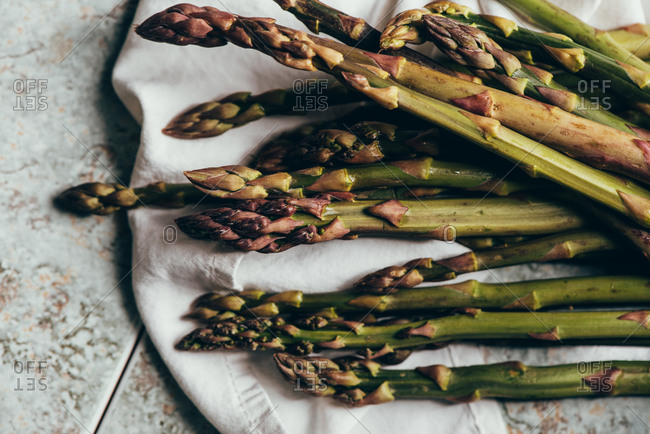 Raw Organic Asparagus Spears, on rustic surface