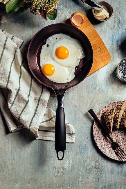 Fried egg. view of two fried eggs on a frying pan. ready to eat with breakfast or lunch