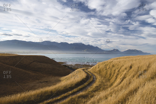 Lonely coastal road with a view of the mountains of Kaikoura, Canterbury, New Zealand
