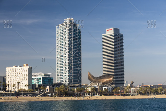 May 15, 2015: Skyscrapers and sculpture 'El Peix' (The Fish) of architect Frank Gehry by the promenade and beach, Port Olympic, Barcelona, Catalonia, Spain
