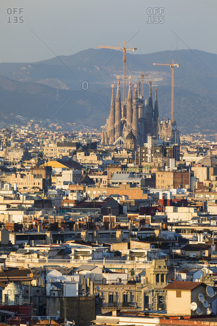 February 25, 2017: View over rooftops of Barcelona City to the Sagrada Familia, sunset, Barcelona, Catalonia, Spain