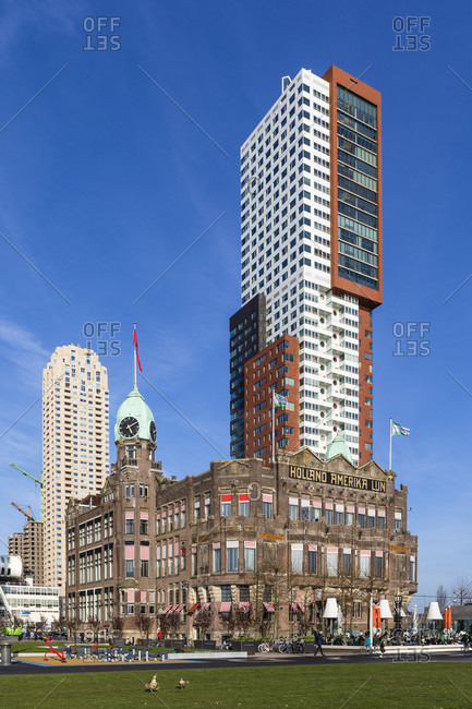 March 24, 2017: Historic Hotel New York of the Holland-America-Line framed by highrises, Rotterdam, South Holland, Netherlands