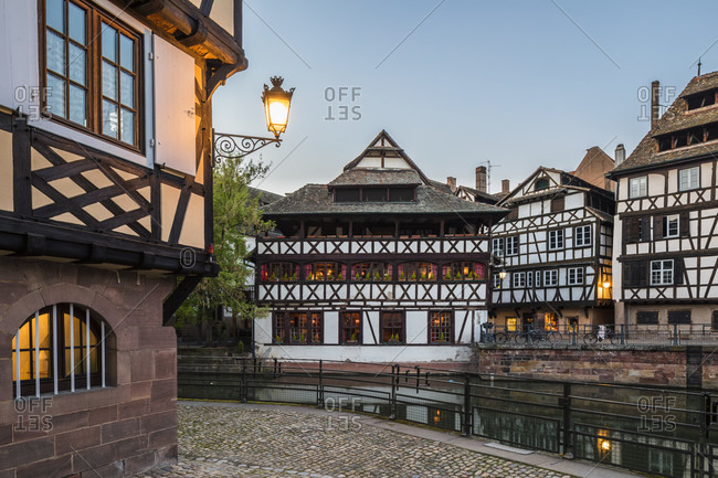 Half-timbered houses at the tanners quarter by River Ill, sunset, Petite France, Old City, Strassbourg, Elsass, Grand Est Region, France