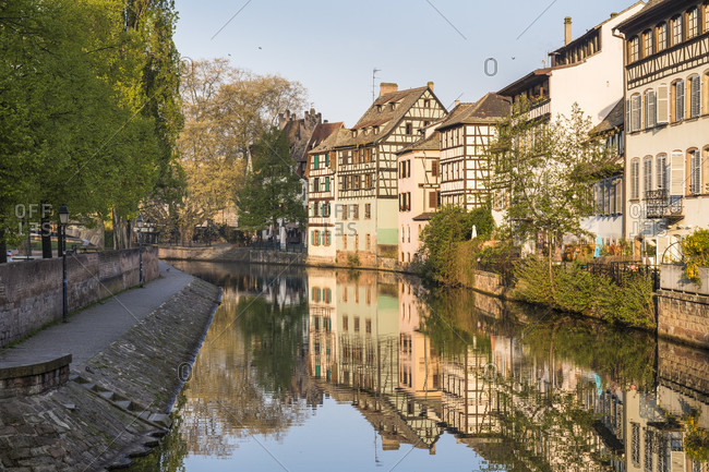 Half-timbered houses reflecting in River Ille, Petite France, Old City, Strasbourg, Elsass, Grand Est Region, France