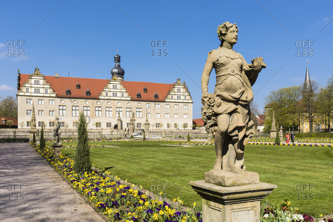 April 8, 2017: Weikersheim Palace (Schloss Weikersheim) and the Baroque garden with many statues, Weikersheim, Hohenlohe Region, Taubertal Valley, Romantische Strasse (Romantic Road), Baden-Wuerttemberg, Germany
