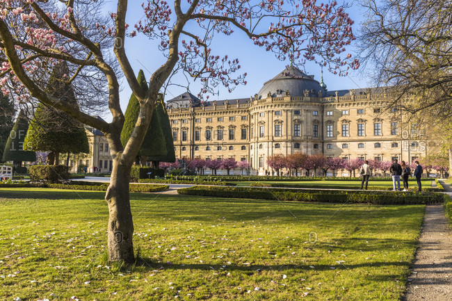 April 8, 2017: Wuerzburg Residence and blooming Magnolia Tree in the Court Gardens, Wuerzburg, Baden-Wuerttemberg, Germany