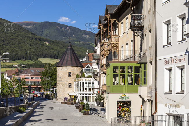 May 28, 2017: Pedestrian area with the city tower as part of the city fortification, Bruneck, Puster Valley, Bolzano district, Alps, Dolomites   Trentino, South Tyrol, Alto Adige, Italy