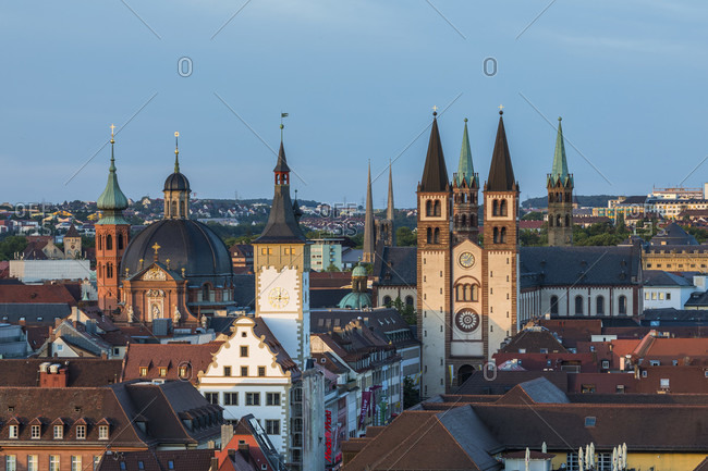 June 12, 2017: Elevated view of the City with Neumuenster Collegiate Church, Town Hall called Grafeneckart and St. Kilian's Cathedral at dusk, Wuerzburg, Lower Franconia, Bavaria, Germany