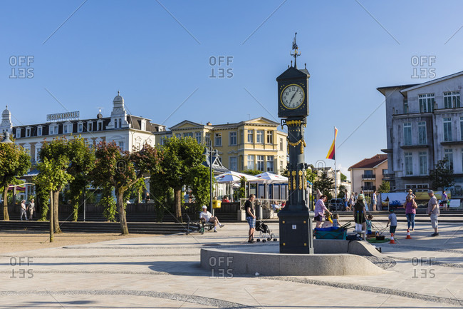 June 19, 2017: Historic clock on a square with typical spa sytle buildings, a Baltic Seaside Resort, Ahlbeck, Usedom Island,   Mecklenburg-Vorpommern, Mecklenburg-Western Pomerania, Germany