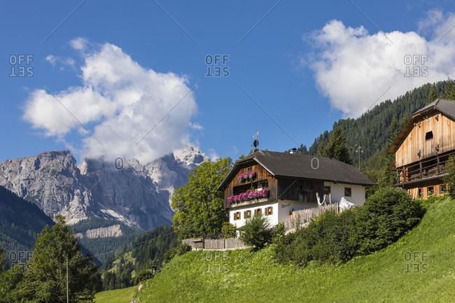 July 18, 2017: Farm building in front of Puez Mountain Group, Pespach, Campill, Longiaru Valley, Val Badia, Bolzano district, South Tyrol, Alto Adige, Dolomites, Trentino-Alto Adige   Italy