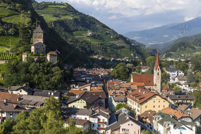August 4, 2017: Elevated village view with Torre del Capitano, Burghauptmannsturm of the Branzoll Castle and the parish church, Klausen, Isarco Valley, Alps, Dolomiten, Trentino, Alto Adige, South Tyrol, Italy
