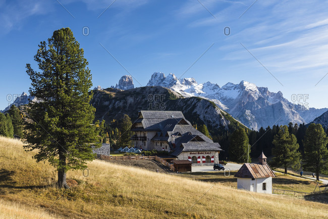October 5, 2017: Alpine Hotel Hohe Gaisl and little chapel on the high plateau Plaetzwiese, Fanes-Sennes-Prags Nature Park, Pragser Dolomites, Dolomites, South Tyrol, TrentinoAlto Adige, Italy