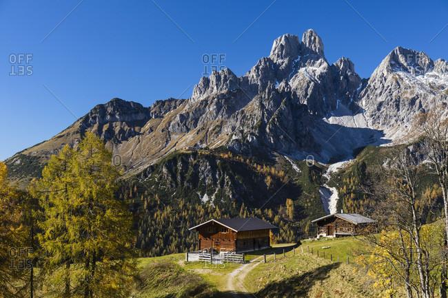 Huts and Bischofsmuetze (2458m) in autumn, Sulzenalm, Dachstein Range, Filzmoos, Pongau, Salzburg, Austria