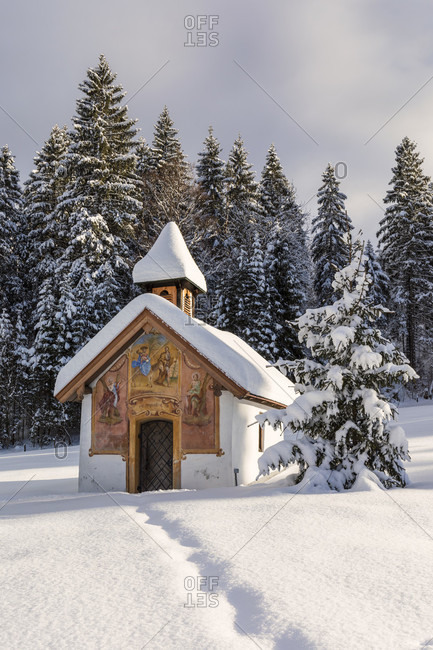 January 9, 2017: Little chapel and christmas tree in winter landscape, near Elmau, Klais, Upper Bavaria, Bavaria, Germany