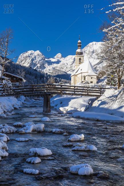 Parish Church St. Sebastian by the River Ramsauer Ache in front of Reiteralpe, winter, Ramsau, Berchtesgaden, Bavaria, Germany