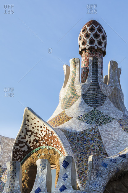 May 15, 2015: Park Güell by Antonio Gaudi, buildings showing the famous colorful mosaic tiles, Barcelona, Catalonia, Spain
