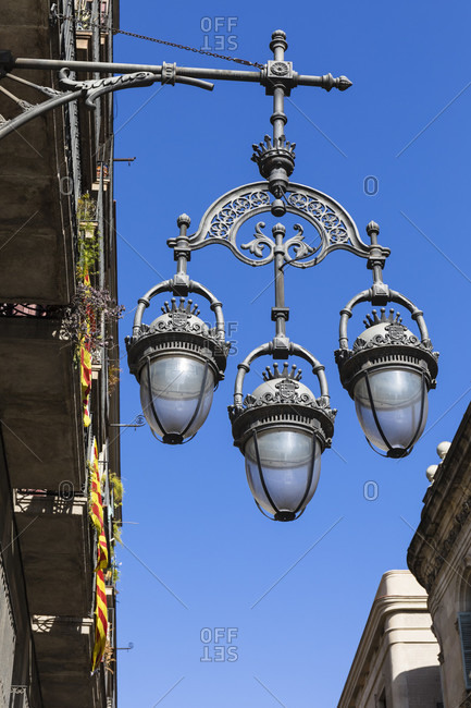 Old street lantern by city buildings, Placa de Sant Jaume, Barri Gotic, Old Town, Barcelona, Catalonia, Spain