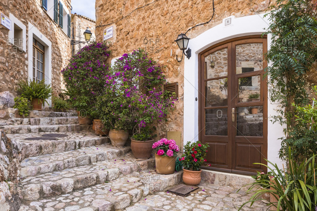 Alley decorated with flower pots, Fornalutx, Mallorca, Balearic Islands, Spain