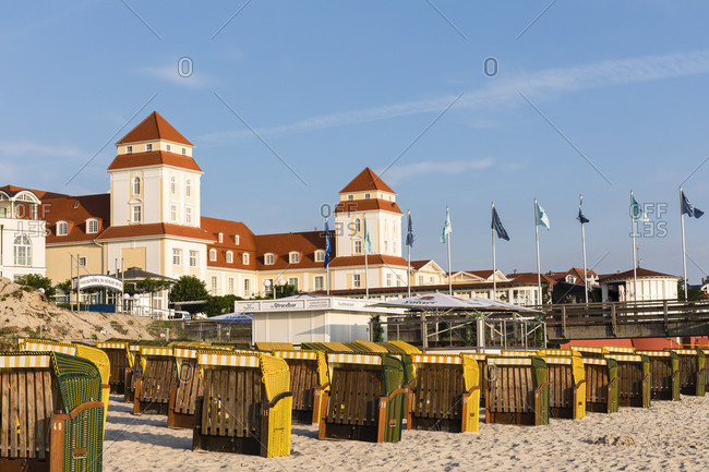 May 15, 2015: Roofed wicker chairs on the beach in front of the Kurhaus, Spa House, Seaside Resort of Binz, Ruegen Island, Insel Rügen, Baltic Sea, Mecklenburg-Vorpommern, Mecklenburg-Western Pomerania, Germany
