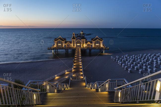 May 15, 2015: Illuminated pier of the Baltic Seaside Resort of Sellin, dusk, Ruegen Island, Insel Rügen, Baltic Sea, Mecklenburg-Vorpommern, Mecklenburg-Western Pomerania, Germany
