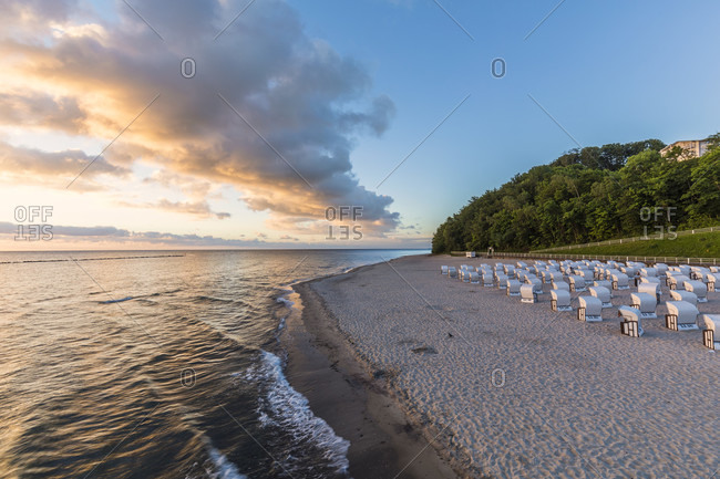 Roofed wicker charis on the beach at sunrise, Baltic Seaside Resort of Sellin, dawn, Ruegen Island, Insel Rügen, Baltic Sea, Mecklenburg-Vorpommern, Mecklenburg-Western Pomerania, Germany