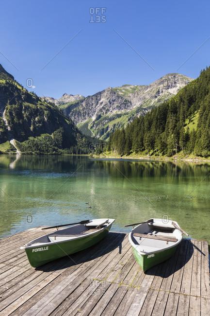 July 5, 2017: Boats at Vilsalpsee against Kugelhorn (2126m), Tannheim, Tannheimer Tal, Ausserfern, Tirol, Austria