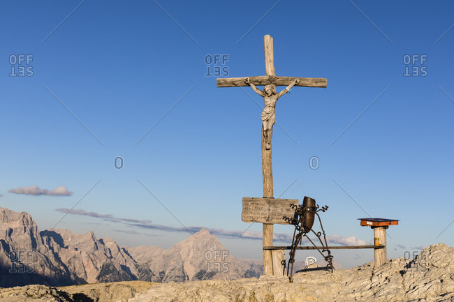 July 15, 2017: Memorial cross of the First World War on the top of Lagazuoi (2778m) at sunset, Cortina d'Ampezzo, Dolomites, Veneto Province Belluno, Italy