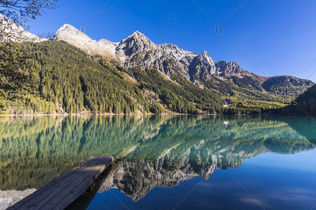 Anterselva lake in autumn in front of the Mountains of the Nature Park Rieserferner-Ahrn, Valle di Anterselva, Pusteria Valley, Dolomites, Bolzano district, South Tyrol, TrentinoAlto Adige, Italy