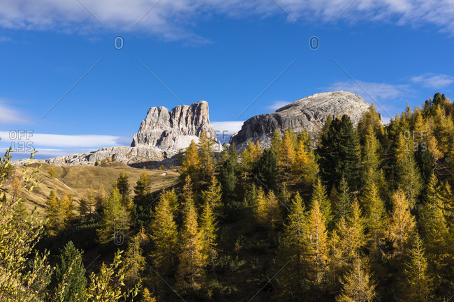 Monte Averau (2649m) in autumn landscape with colorful larch trees, Falzarego Pass, Dolomites, Province of Belluno, Veneto, Italy