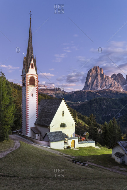 Illuminated St. Jakob church in front of Langkofel Group (3181m), St. Jakob, Groeden Valley, Dolomites, TrentinoAlto Adige, South Tyrol, Italy
