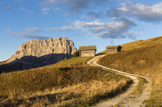 Langkofel Mountain and hay barns in autumn on Gardena Pass, Groedner Joch, Dolomites, TrentinoAlto Adige, South Tyrol, Italy