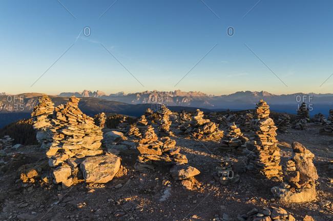 Hohe Reisch mountain (2003m) with multiple cairns, sunset, Sarntaler Alpen, Sarntheim Sarntal, Province Bolzano, TrentinoAlto Adige, South Tyrol, Italy