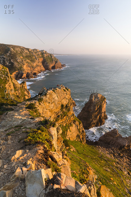 Steep cliffs at Cabo da Roca, the wersternmost point in Europe at sunset, Sintra-Cascais Nature Park, Sintra, Greater Lisbon, Portugal