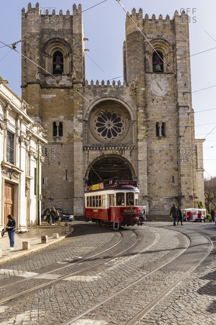 Tram in front of the Se Cathedral, Lisbon, Portugal