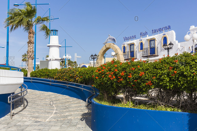March 8, 2016: Restaurant Vassos Fish Taverna, blue windows and white washed building at the harbor, Agia Napa, Cyprus