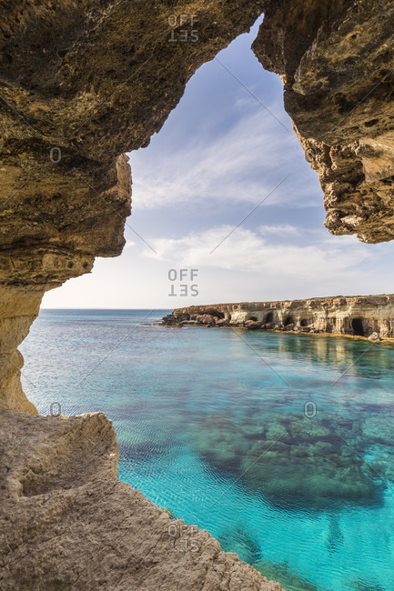 Sea caves along the rocky coast by the Mediterranean Sea, Cape Greco, National Forest Park, Agia Napa, Cyprus