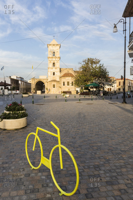 March 9, 2016: Yellow artifical bicycle frame in front of the Agios Lazaros Church, Larnaca, Cyprus