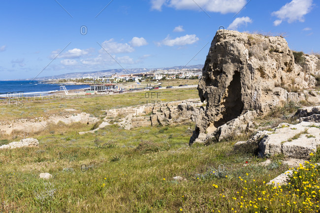 View over a stone pit of the ruined Roman town at the Archaeological Park of Paphos to the beach, UNESCO World Heritage Site, Paphos, Cyprus