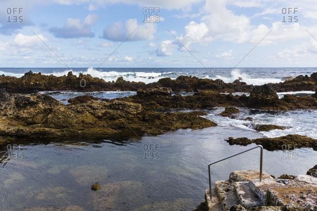 Natural pools within the rocky lava coast near the Atlantic Ocean
