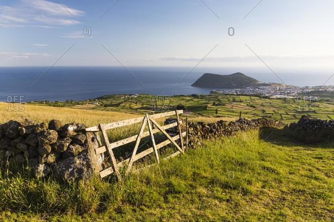 Gate to a field and view to Angra do Heroismo in the distance, Serra da Ribeirinha