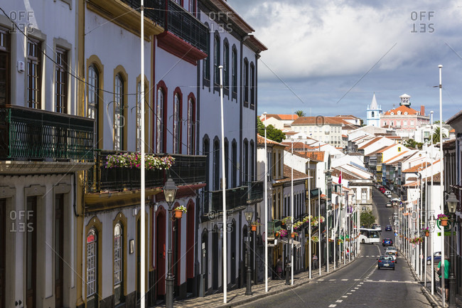 July 4, 2015: Main street with typical house facades, Church of Misericoria in the distance, UNESCO World Heritage Site