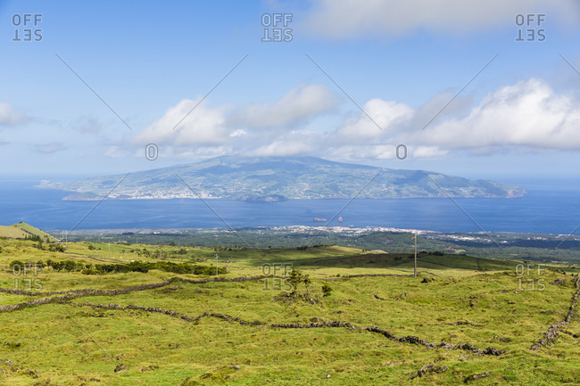 Pastureland in front of a view to Faial in the distance