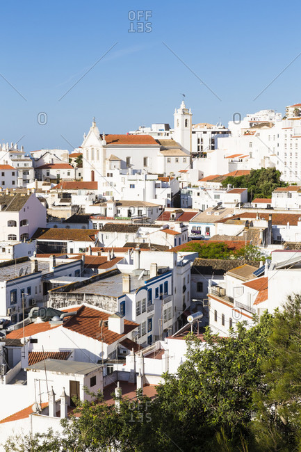 View on white washed buildings in Albufeira's old town and its parish church