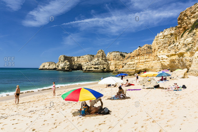 May 15, 2015: People sunbathing among rock formations on Praia da Marinha