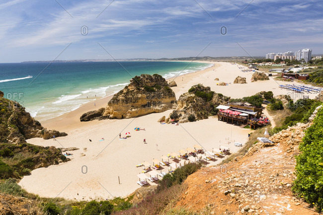 May 11, 2015: Elevated view on the sandy beach and rock formations at Praia dos Tres Irmaos