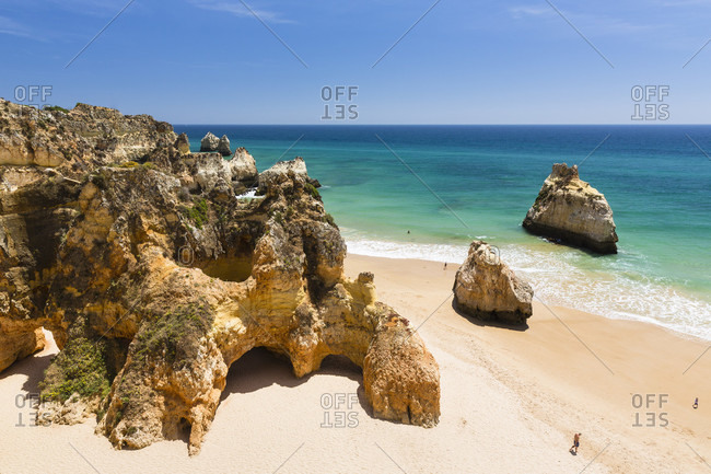 Elevated view on the sandy beach and rock formations at Praia dos Tres Irmaos