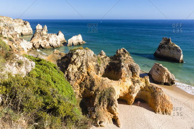 Elevated view on sandy beach and rock formations at Praia dos Tres Irmaos