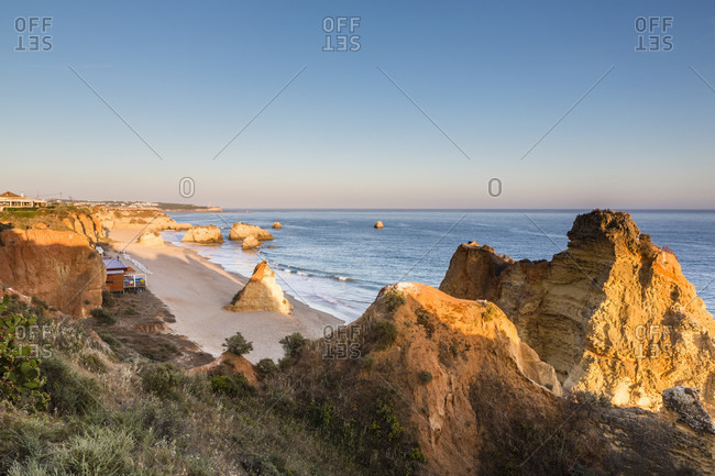 Elevated view on sandy beach and rocks at Praia da Rocha, sunset