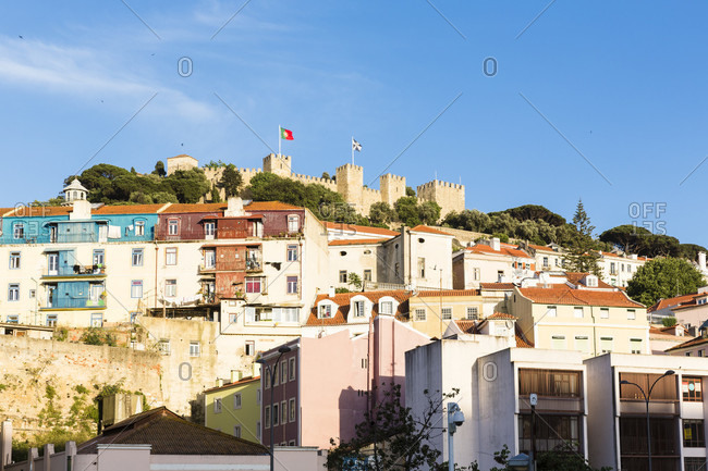 View of the hilltop fortification Castelo de Sao Jorge from Largo Martim Moniz, Alfama district